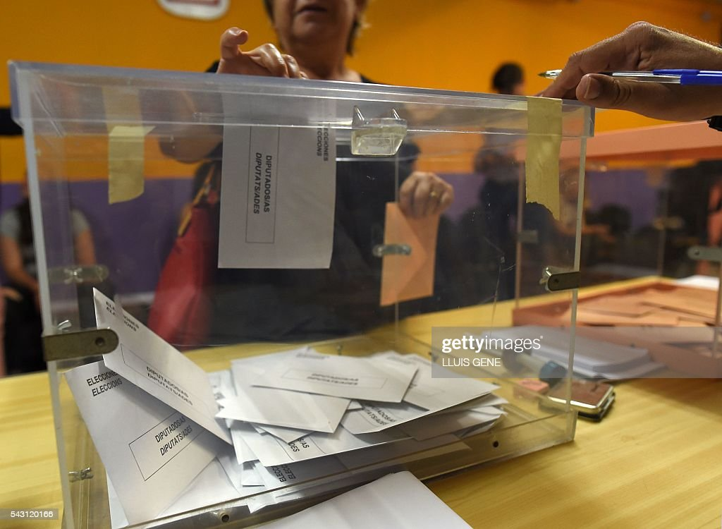 A woman casts her vote in Spains general election at a polling station in Hospitalet, near Barcelona on June 26, 2016. Spain votes today, six months after an inconclusive election which saw parties unable to agree on a coalition government. GENE