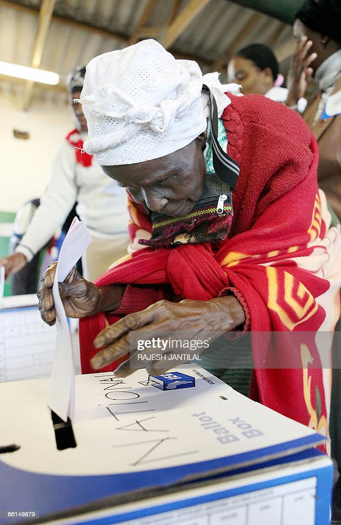 A woman casts her vote in the country's fourth democratic general elections the Ntolwane Primary school in the rural village of Nkandla some 350 kms...