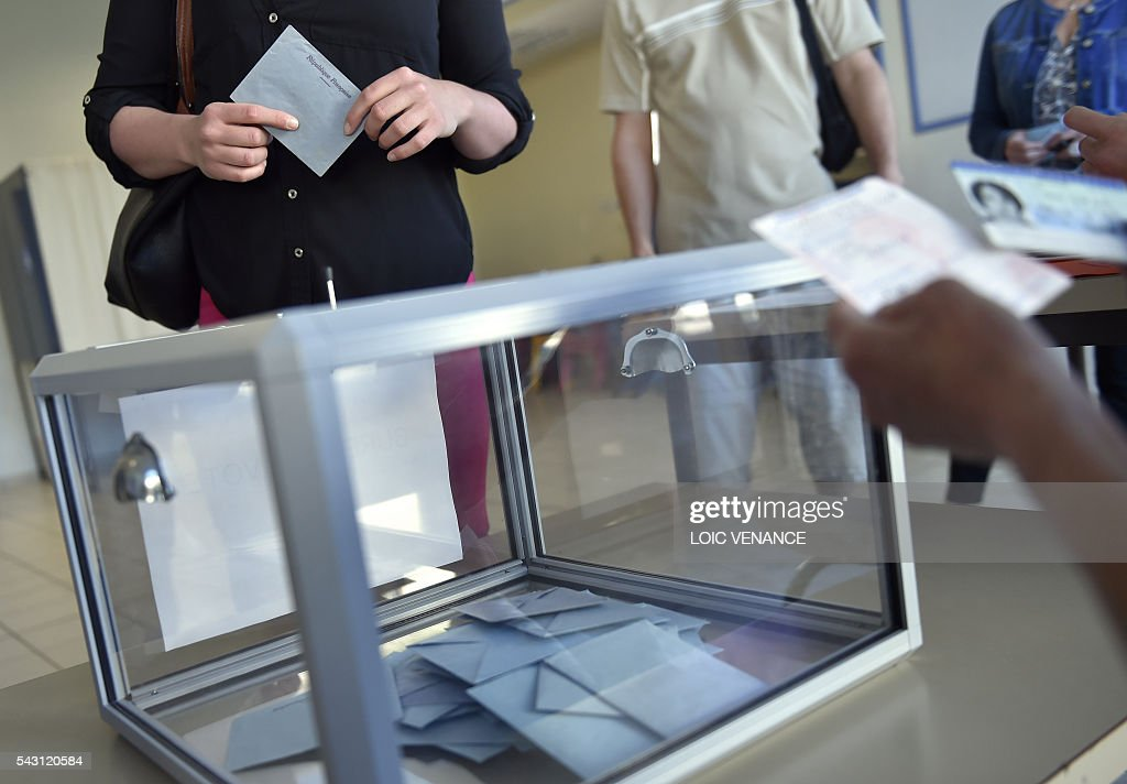 A woman casts her vote on June 26, 2016 in Notre-Dame-des-Landes during a local referendum organised in Loire-Atlantique on subject of the Notre-Dame-des-Landes' airport project. Nearly One million people living in France's Loire-Atlantique department are voting in a referendum which poses the question 'Are you in favour of the project to transfer the Nantes-Atlantique airport to the municipality of de Notre-Dame-des-Landes?' to voters. The referendum was organised by the French executive power hoping to find a solution to the issue which has dragged on for 50 years. / AFP / LOIC