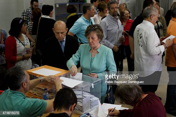 A woman casts her votes at a polling station on May 24 2015 in Madrid Spain Spaniards are going to the polls today to vote for mayors and presidents...