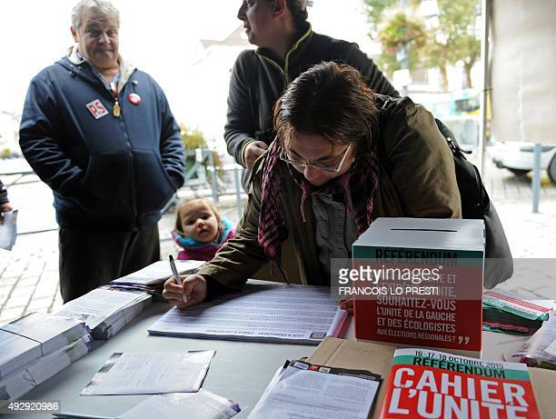 A woman casts her votes on October 16 in Anzin for the selfcalled 'referendum' organized by the French Socialist Party on the question of the unity...