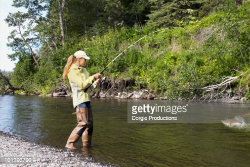 Waders stock photos and pictures getty images for Womens fishing boots