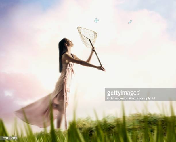 Woman catching butterflies with net