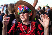 A woman celebrates a concert at the 2015 Woodstock Festival Poland on August 1 2015 in Kostrzyn Poland The Polish Woodstock music festival also...