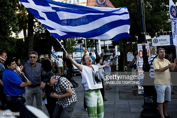 A woman celebrates at Syntagma Square in Athens on July 5 2015 after the first exitpolls of a referendum on austerity measures A referendum to decide...