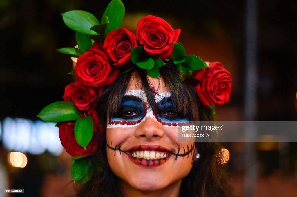 A woman celebrates Halloween in Bogota on October 31, 2014. Every year more and more people in Colombia are taking part in the Halloween celebrations. AFP PHOTO/Luis Acosta /