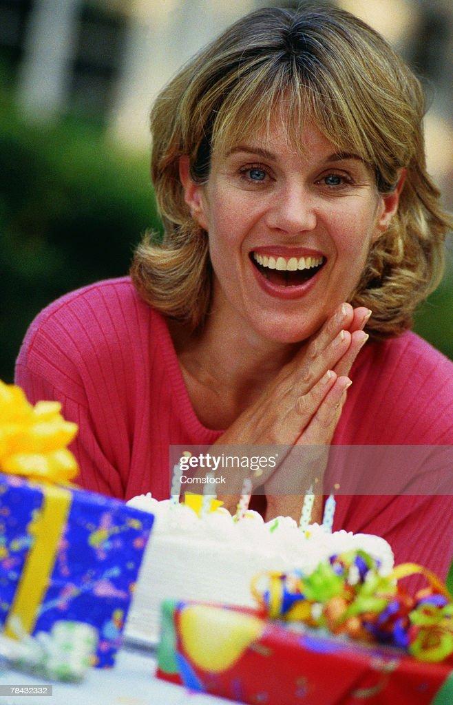 Woman celebrating her birthday : Stock Photo