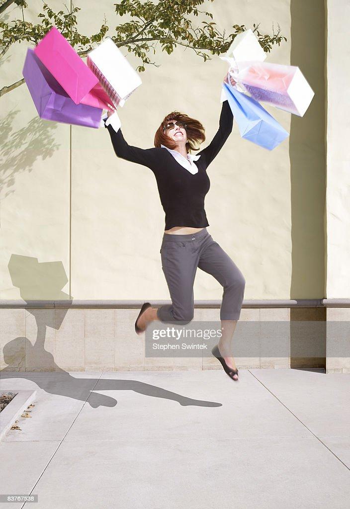 Woman celebrating shopping success : Stock Photo