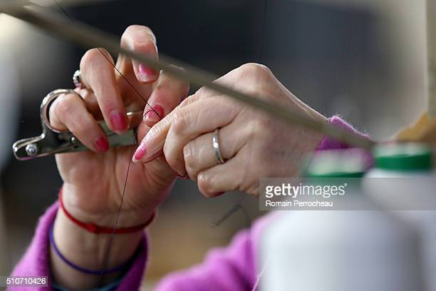 A woman changes the thread at the Charentaise slipper factory 'Manufacture Degorce' on February 16 2016 in Marthon France The genuine Charentaise...