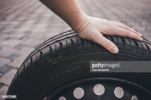 Woman changes tires