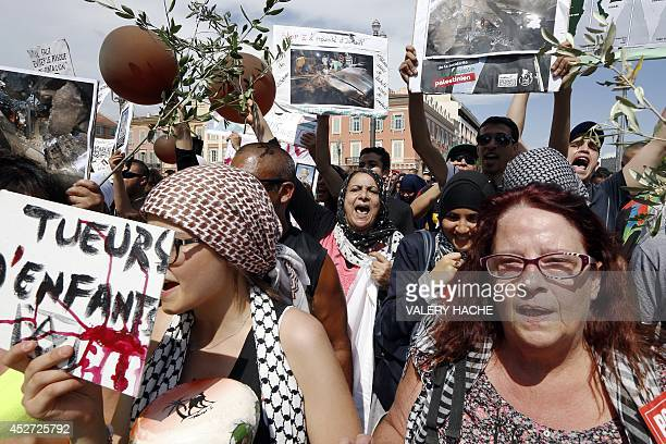 A woman chants slogans during a demonstration against Israel's military operation in Gaza and in support of the Palestinian people in Nice...