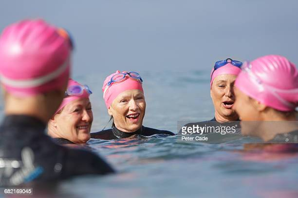 Woman chatting in sea after swim