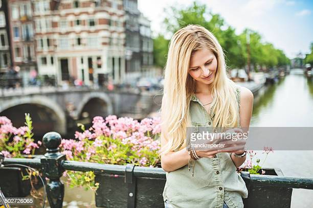 woman chatting on the phone in amsterdam - urban scene