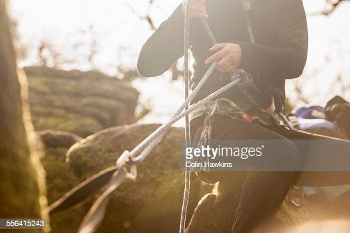 Woman checking climbing ropes