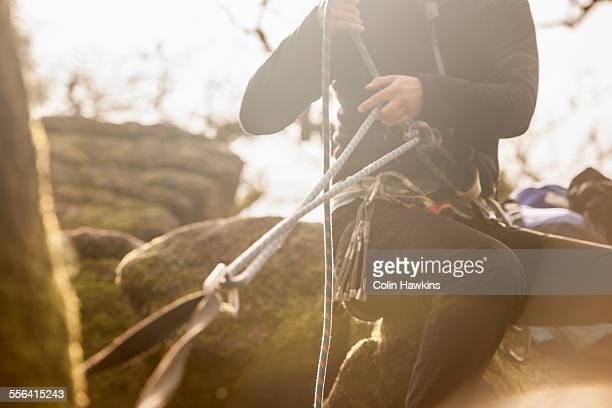 Woman checking climbing ropes