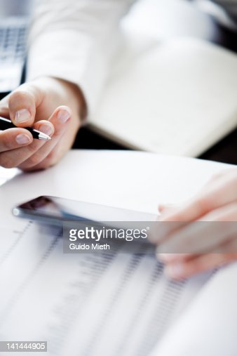 Woman checking email in office. : Stock Photo