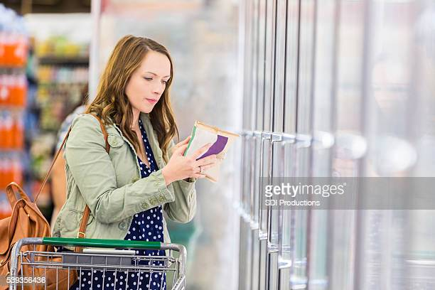 Woman checking food label