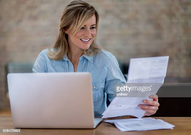 Woman checking her home finances