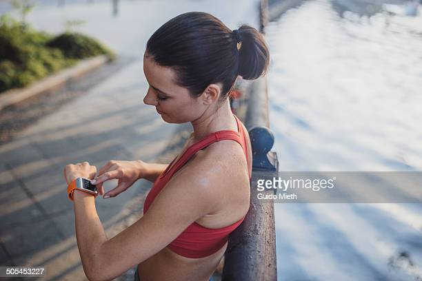 Woman checking her pulse after sport.