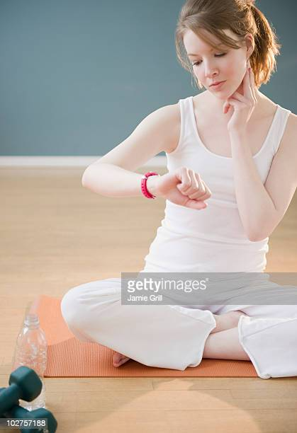 Woman checking her pulse