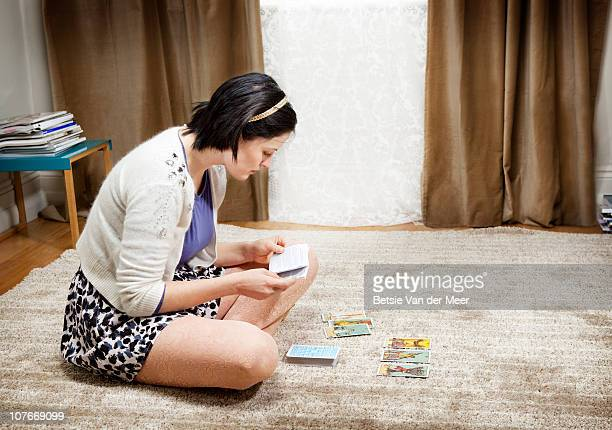 Woman checking meaning of tarotcards.