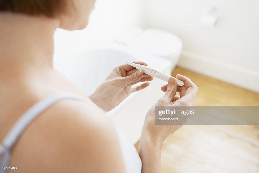 Woman Checking Pregnancy Test Kit : Stock Photo