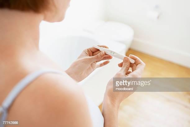 Woman Checking Pregnancy Test Kit