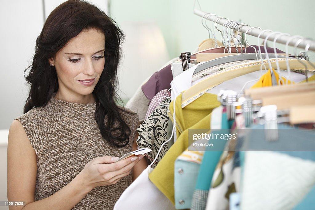 woman checking price tag