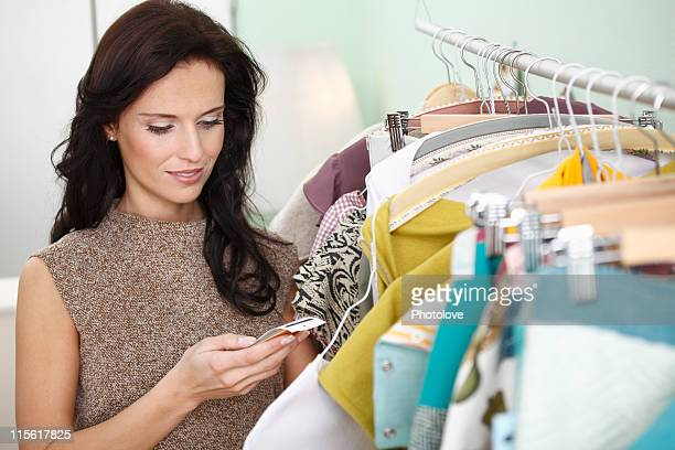 woman checking price tag