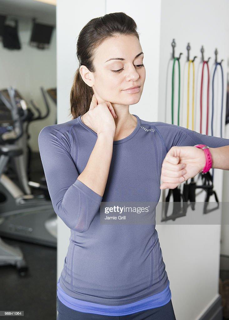 Woman checking pulse at gym