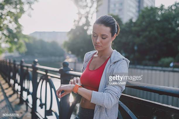 Woman checking smartwatch after sport.
