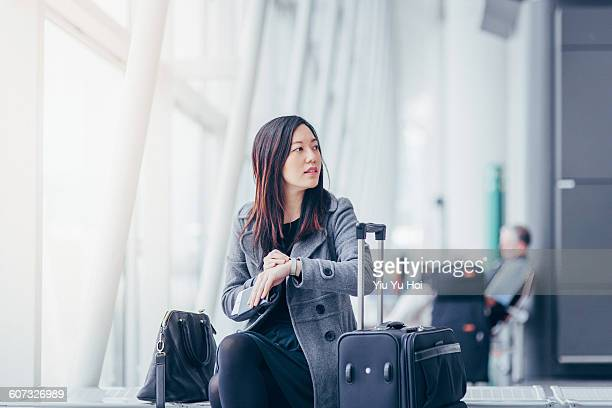 Woman checking the time while waiting at airport