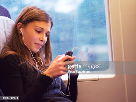 Woman checks cell phone : Stock Photo