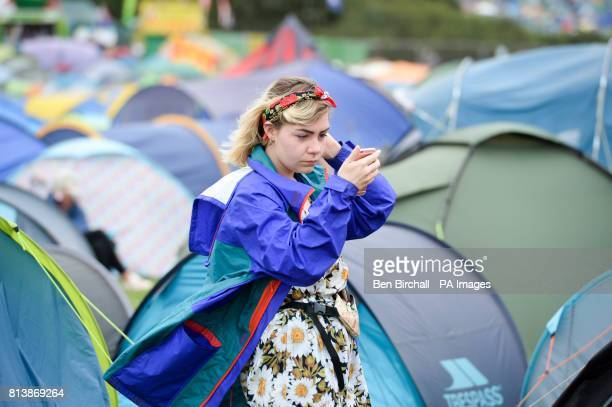 A woman checks her makeup at Glastonbury Festival Worthy Farm Somerset PRESS ASSOCIATION Photo Picture date Sunday June 2017 Photo credit should read...