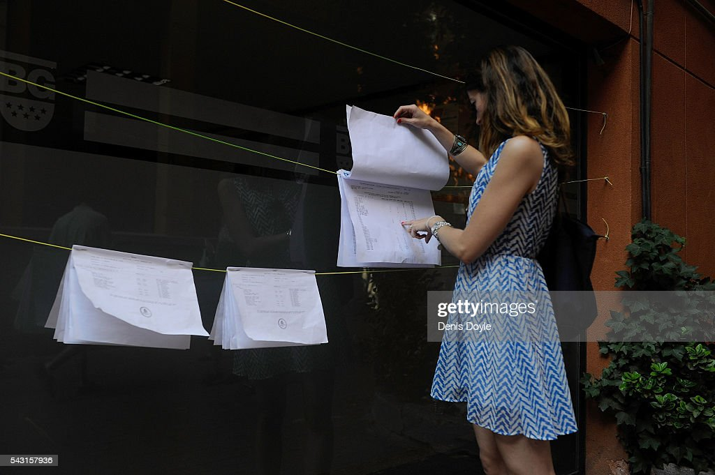 A woman checks to see which room she has to vote in at a polling station for the Spanish general election on June 26, 2016 in Madrid, Spain. Spanish voters headed back to the polls on June 26 after the last election in December failed to produce a government. Latest opinion polls suggest the Unidos Podemos left-wing alliance could make enough gains to come in second behind the caretaker government of the center-right Popular Party.