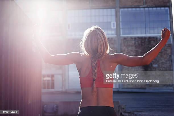 Woman cheering in industrial area