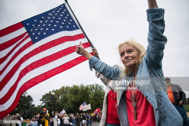 A woman cheers at a rally centered around reopening national memorials closed by the government shutdown supported by military veterans Tea Party...