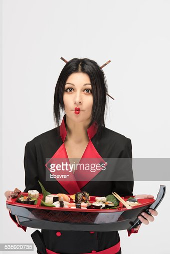 Woman chef in black red dress making duck face : Stock Photo