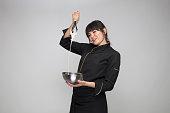 woman chef preparing mortar