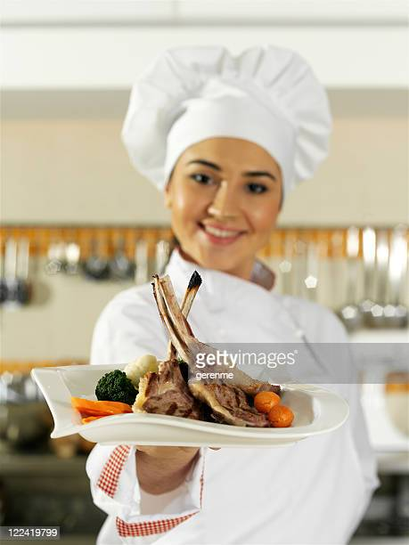 woman chef serving meat plate