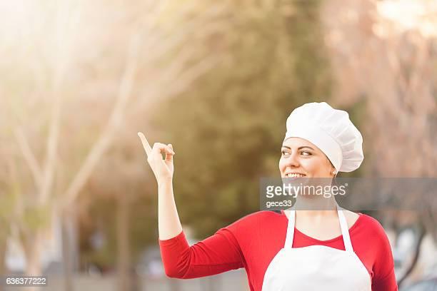 Woman Chef thinking bokeh background