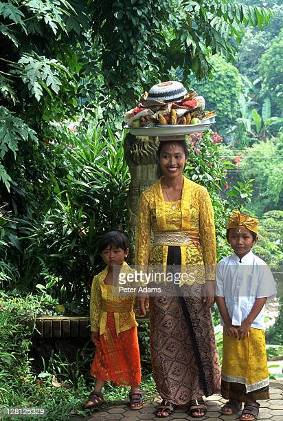 woman & children at festival, bali, indonesia