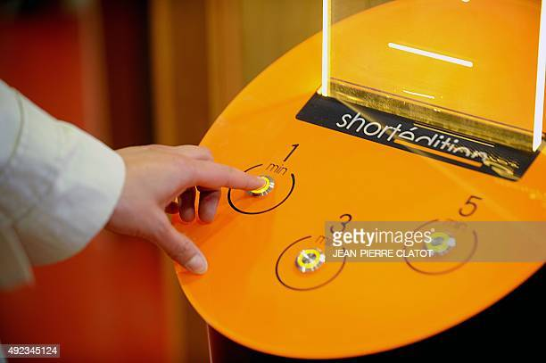 A woman chooses a short story at a shortstory distribution terminal in the Mistral district of Grenoble on October 12 2015 The city of Grenoble is...