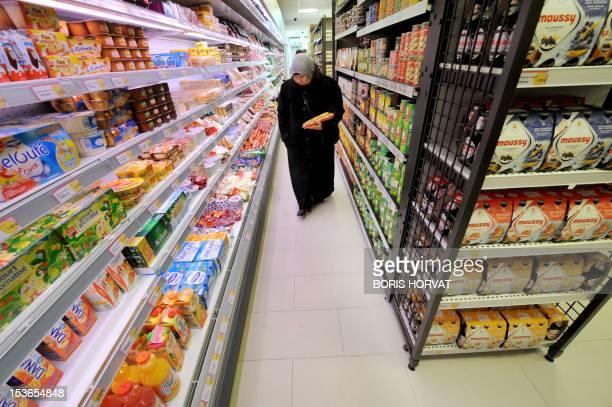 'UN COMMERCE HALAL D'UN NOUVEAU GENRE OUVRE SES PORTES EN REGION PARISIENNE' A woman chooses food at 'Hal' shop' a supermarket selling halal food in...