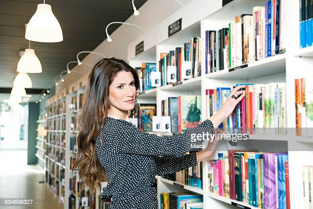 Woman choosing a book