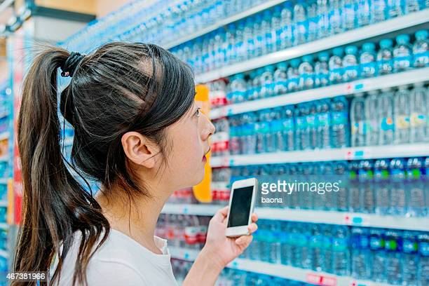 woman choosing bottled water