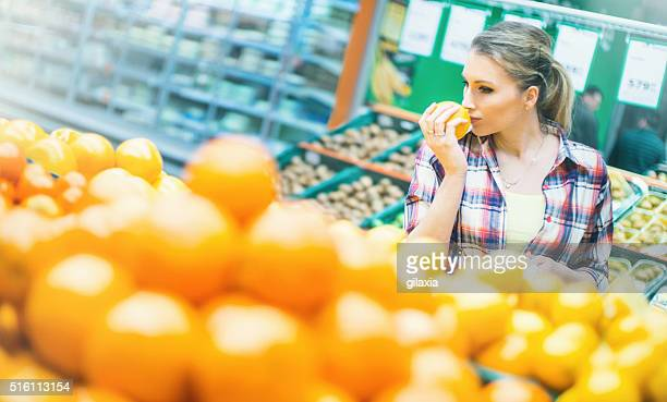 Woman choosing fruit in supermarket.