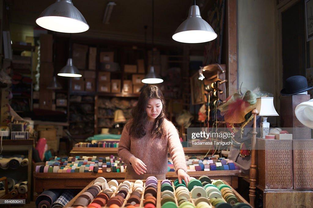 Woman choosing material : Stock Photo