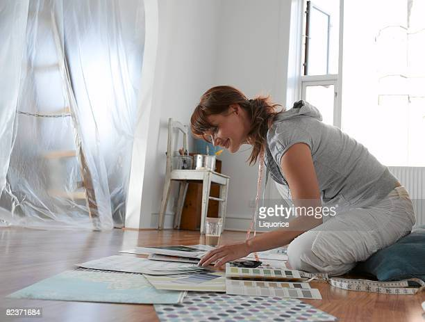 woman choosing paint from swatches