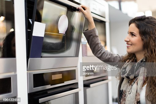 Woman choosing stove